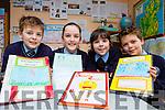 Darragh O'Shea, Ailbhe Brosnan, Saoirse Sweeney and Keelan O'Shea with their Scríobh Leabhar projects for Seachtain na Gaeilge