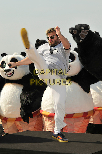 """JACK BLACK.Photocall for """"Kung Fu Panda"""" on The Carlton Hotel pier at the 61st Cannes International  Film Festival, Cannes, France..14th May 2008 .full length white trousers grey gray top leg up kicking funny gesture beard facial hair sunglasses shades .CAP/PL.© Phil Loftus/Capital Pictures"""