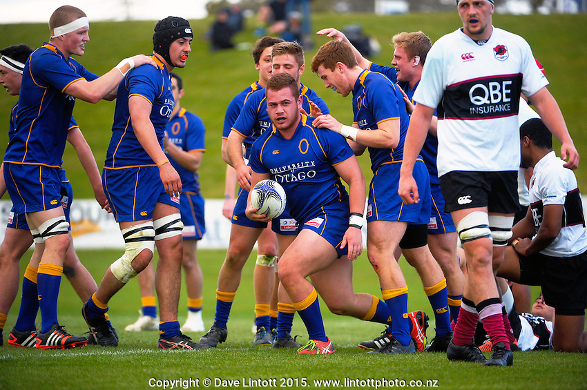 Otago players congratulate Grayson Kite on his try during the Jock Hobbs Memorial Under-19 Provincial rugby union tournament match between Otago (blue and gold) and North Harbour (maroon white and black) at Owen Delaney Park, Taupo, New Zealand on Sunday, 27 September 2015. Photo: Dave Lintott / lintottphoto.co.nz