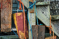 Colorful boat wedges hanging on a harbor shanty, Menemsha, Chilmark, Martha's Vineyard, Massachusetts, USA