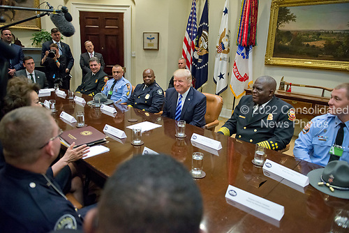 United States President Donald J. Trump meets with the I-85 bridge first responders in the Roosevelt Room of the White House in Washington, DC on Thursday, April 13, 2017.<br /> Credit: Ron Sachs / Pool via CNP