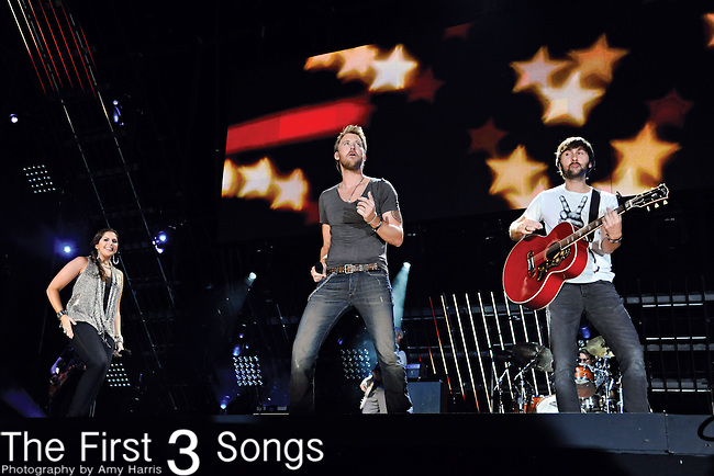 Hillary Scott, Charles Kelley and Dave Haywood of Lady Antebellum perform at LP Field during the 2011 CMA Music Festival on June 10, 2011 in Nashville, Tennessee.
