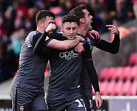 Lincoln City's Shay McCartan, centre, celebrates scoring his side's second goal with team-mates, Lee Frecklington, left, and Harry Toffolo<br /> <br /> Photographer Andrew Vaughan/CameraSport<br /> <br /> The EFL Sky Bet League Two - Swindon Town v Lincoln City - Saturday 12th January 2019 - County Ground - Swindon<br /> <br /> World Copyright &copy; 2019 CameraSport. All rights reserved. 43 Linden Ave. Countesthorpe. Leicester. England. LE8 5PG - Tel: +44 (0) 116 277 4147 - admin@camerasport.com - www.camerasport.com
