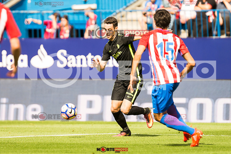 Atletico de Madrid's player Stefan Savic and Sporting de Gijon's player Burgui during a match of La Liga Santander at Vicente Calderon Stadium in Madrid. September 17, Spain. 2016. (ALTERPHOTOS/BorjaB.Hojas) /NORTEPHOTO