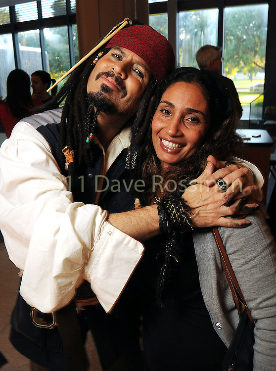 Danny Lopez as Captain Jack Sparrow and Hanan Harkness at a VIP preview of Real Pirates: The Untold Story of the Whydah from Slave Ship to Pirate Ship at the Houston Museum of Natural Science Wednesday Oct. 06, 2010. (Dave Rossman/For the Chronicle)