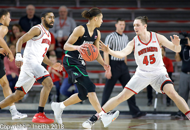 VERMILLION, SD: MARCH 14:  Ryan Woolridge #0 of North Texas drives toward Austin Sparks #45 of South Dakota during the 2018 CBI Basketball Tournament at the Sanford Coyote Sports Center in Vermillion, S.D. At left is Carlton Hurst #2 of South Dakota. (Photo by DIck Carlson/Inertia)