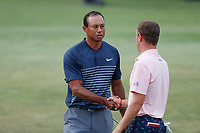 Tiger Woods (USA) shakes hands with Justin Thomas (USA) after finishing on the 18th hole during the first round of the 118th U.S. Open Championship at Shinnecock Hills Golf Club in Southampton, NY, USA. 14th June 2018.<br /> Picture: Golffile | Brian Spurlock<br /> <br /> <br /> All photo usage must carry mandatory copyright credit (&copy; Golffile | Brian Spurlock)
