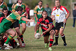 Nathan Pyne puts pressure on Chris Mana as he passes from a ruck. Counties Manukau Premier Club Rugby Game of the Week between Drury & Papakura, played at Drury Domain on Saturday Aprill 11th, 2009..Drury won 35 - 3 after leading 15 - 5 at halftime.