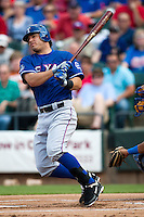 "Texas Rangers second baseman Ian Kinsler #5 swings during the MLB exhibition baseball game against the ""AAA"" Round Rock Express on April 2, 2012 at the Dell Diamond in Round Rock, Texas. The Rangers out-slugged the Express 10-8. (Andrew Woolley / Four Seam Images)."