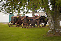 Rusty tractors in field.Vancouver, Canada