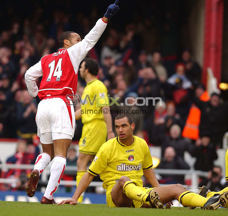 Pix: Daniel Hambury/SWpix.com. Football,.FA Barclaycard Premiership..ARSENAL V CHARLTON ATHLETIC   28/2/04..COPYRIGHT PICTURE>>SIMONWILKINSON>>0870 092 0092>>..Arsenal's Thierry Henry celebrates his goal watched by Charlton's Jonathan Fortune...