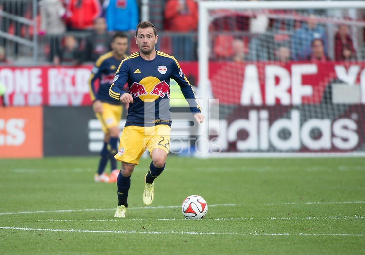Toronto, Ontario - May 17, 2014: New York Red Bulls midfielder Jonny Steele #22 in action during a game between the New York Red Bulls and Toronto FC at BMO Field. Toronto FC won 2-0.