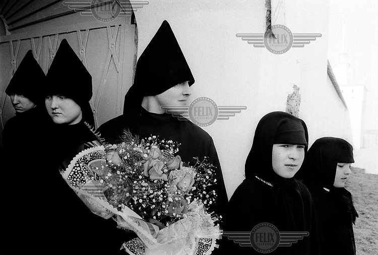Girls from the Russian Orthodox Yaroslavl Monastry wait for the arrival of President Boris Yeltsin...