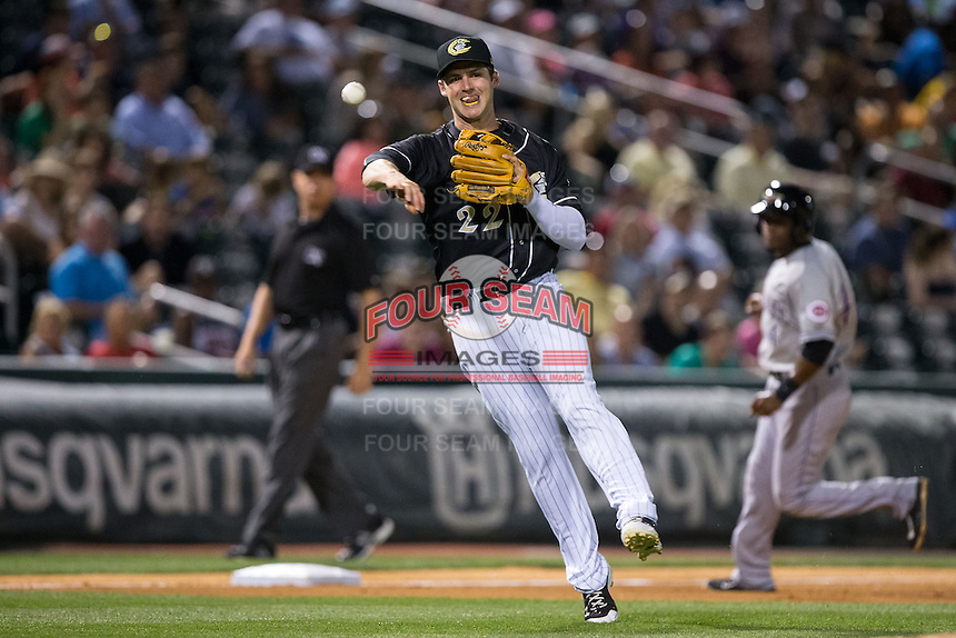 Charlotte Knights third baseman Matt Davidson (22) makes a throw to first base against the Louisville Bats at BB&T BallPark on May 12, 2015 in Charlotte, North Carolina.  The Knights defeated the Bats 4-0.  (Brian Westerholt/Four Seam Images)