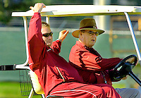 TALLAHASSEE, FL. 11/14/06-Florida State University Offensive Coordinator Jeff Bowden, left, talks with his father Coach Bobby Bowden after announcing that he will leave his position with the Seminoles at the close of this season, Tuesday in Tallahassee. Jeff Bowden will remain an employee of FSU through the remainder of his contract, which ends August of 2008, but will not be working in the athletic department. COLIN HACKLEY PHOTO