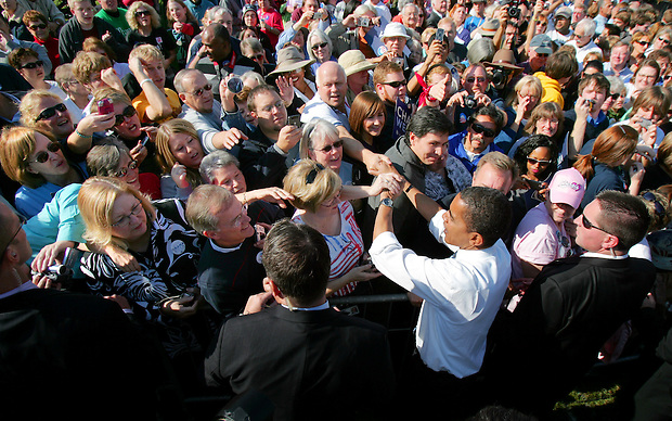 Democratic presidential nominee Sen. Barack Obama greets supporters following a campaign rally in downtown Des Moines, Friday, October 31, 2008, just four days before the general election.  Obama returned Iowa, where he won his first victory on his path to the nomination- the Iowa caucuses, eleven months before.