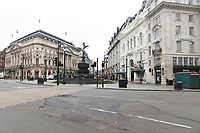 View of Piccadilly Circus. The deserted streets show the severe effects of the COVID-19 epidemic on London on the morning of 19th March 2020