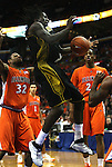 23 December 2008:   Mizzou's DeMarre Carroll (1, center) loses the ball as he goes up for a layup in the second half.  At left is Illini player DeMetri McCamey (32) and at right is Illini's Mike Davis (24).  The University of Missouri and the University of Illinois competed in the annual Busch Braggin' Rights basketball game at the Scottrade Center in downtown St. Louis, Missouri on Tuesday December 23, 2008...