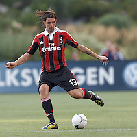 AC Milan defender Francesco Acerbi (13) passes the ball. In an international friendly, AC Milan defeated C.D. Olimpia, 3-1, at Gillette Stadium on August 4, 2012.