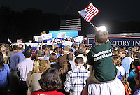 A young boy holds an American flag as Republican vice presidential nominee Paul Ryan rallied a crowd of about 1,500 during a campaign stop Thursday evening at the Crutchfield Corporation in Albemarle County, Va.