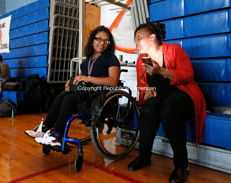 Oxford, CT- 17 November 2016-111716CM04- Kennedy High School student, Crystal Medina, left, chats with Shawntina Hodges, a para-professional, during a CT Unified Sports Dance at Oxford High School on Thursday. Approximately 150 athletes, both special needs and non-disabled peers attended the event which featured music by Waterbury DJ Frank Calabro.    Christopher Massa Republican-American