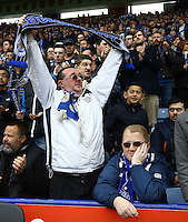 One Leicester fan cheers his side on as another look disinterested during the Barclays Premier League match between Leicester City and Swansea City played at The King Power Stadium, Leicester on 24th April 2016
