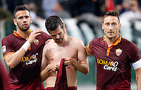 Calcio, Serie A: Roma vs Milan. Roma, stadio Olimpico, 25 aprile 2014.<br /> AS Roma midfielder Miralem Pjanic, of Bosnia, center, celebrates with teammates Leandro Castan, of Brazil, left, and, Francesco Totti, after scoring during the Italian Serie A football match between AS Roma and AC Milan at Rome's Olympic stadium, 25 April 2014.<br /> UPDATE IMAGES PRESS/Riccardo De Luca