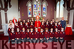 The Bishop of Kerry Ray Browne who confirmed the pupils of Glenderry NS Ballyheigue on Wednesday in St Mary's Church,Ballyheigue on Tuesday with their pupils were, Gerv Pierce (principal) Fr O'Mahony and Mary Griffin (teacher)