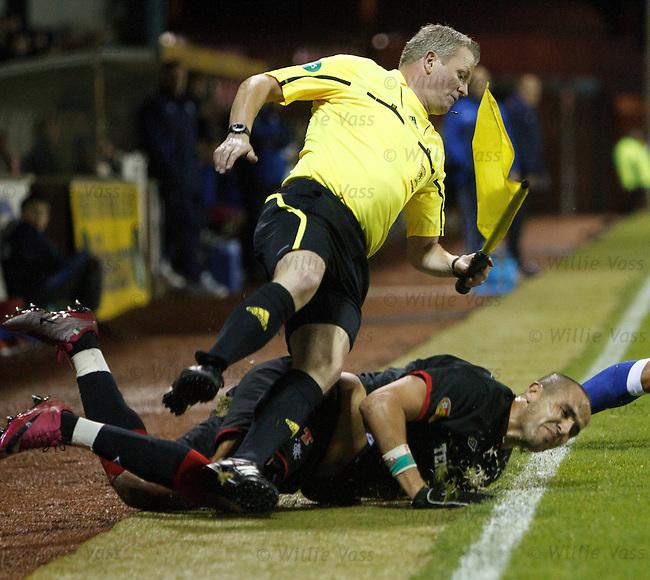 Madjid Bougherra slide tackles linesman Gary Sweeney and sends him flying