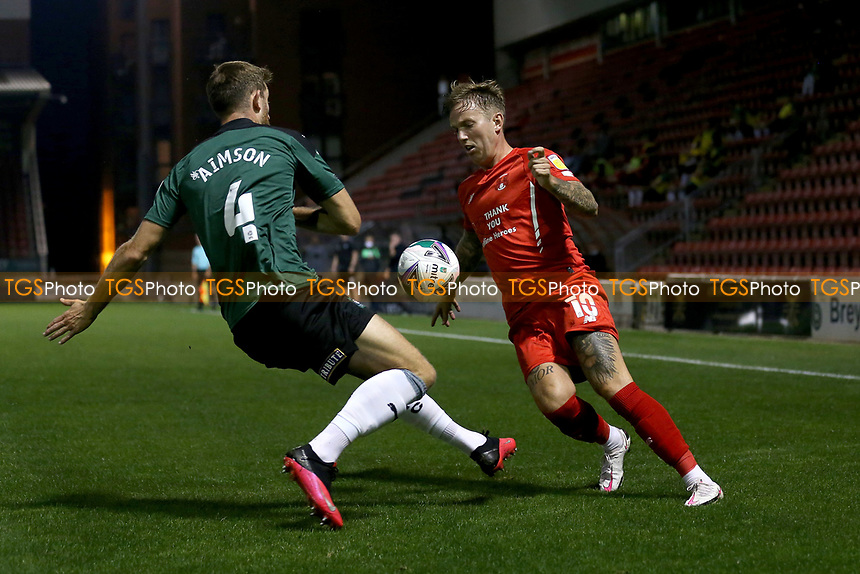 Jordan Maguire-Drew of Leyton Orient and Will Aimson of Plymouth Argyle during Leyton Orient vs Plymouth Argyle, Caraboa Cup Football at The Breyer Group Stadium on 15th September 2020