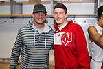 Wisconsin Badgers Zak Showalter with Green Bay Packers quarterback Aaron Rodgers after  a regional semifinal NCAA college basketball tournament game against the Baylor Bears Thursday, March 27, 2014 in Anaheim, California. The Badgers won 69-52. (Photo by David Stluka)