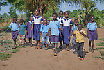 Students walk to a primary school in Bunj, South Sudan, sponsored by Jesuit Relief Service. The community is host to more than 130,000 refugees from the Blue Nile region of Sudan. JRS, with support from Misean Cara, provides educational and psycho-social services to both refugees and the host community.