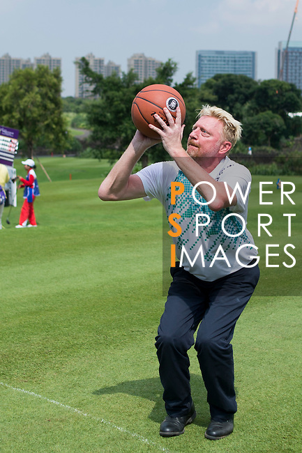 Boris Becker throws a basketball during the World Celebrity Pro-Am 2016 Mission Hills China Golf Tournament on 23 October 2016, in Haikou, Hainan province, China. Photo by Marcio Machado / Power Sport Images