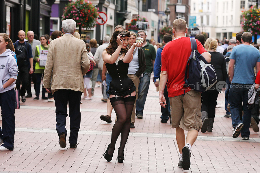 25/8/2010.  Renowned Burlesque Artist Kitty Bang Bang is pictured on Grafton st Dublin after performing a burlesque dance in the Cosmetics Hall of Brown Thomas Dublin to celebrate the exclusive arrival of fragrance house Penhaligon's to Brown Thomas.  Picture James Horan/Collins