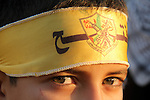 A Palestinian child wears a headband of Fatah movement during a rally in Gaza city on December 31, 2012. The Gaza branch of Palestinian president Mahmud Abbas's Fatah party said on Friday it will mark its anniversary in the Hamas-ruled enclave after an accord between the two factions. Photo by Ezz al-Zanoon