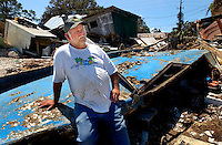 Eastpoint, Fl. 7/12/05-John Polous sets on the remains of his shrimp boat the Miss Gennie, Tuesday in Eastpoint. Polus' boat and all of the seafood houses in the coastal village sustained heavy damage from Hurricane Dennis. COLIN HACKLEY PHOTO