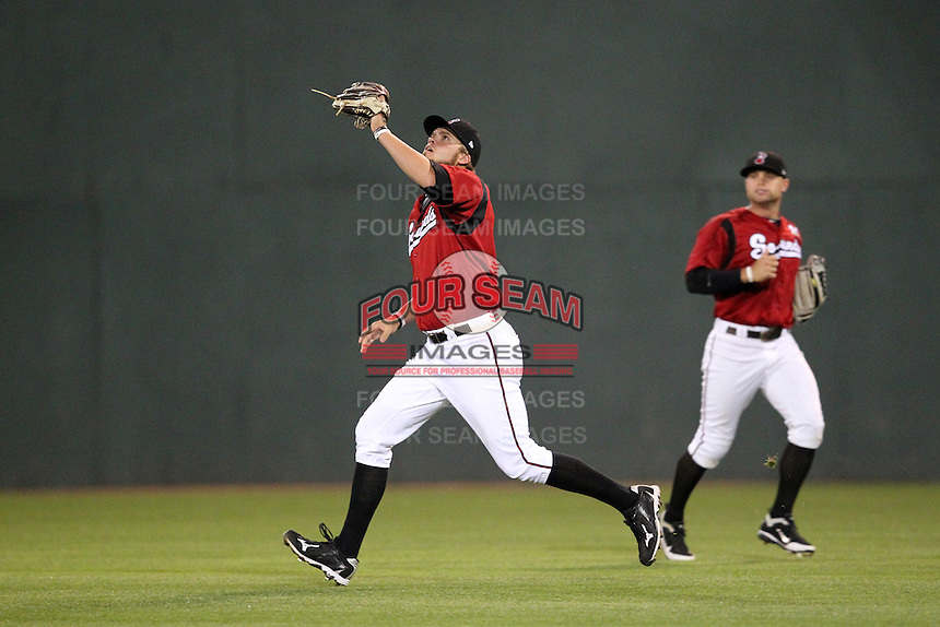 Nashville Sounds outfielder Corey Hart #41 tracks a fly ball as Brett Carroll backs him up during a game against the Omaha Storm Chasers at Greer Stadium on April 25, 2011 in Nashville, Tennessee.  Omaha defeated Nashville 2-1.  Photo By Mike Janes/Four Seam Images