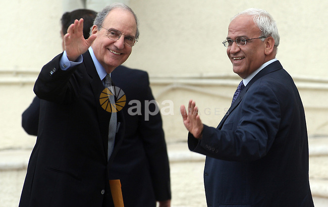 US special envoy to the Middle East George Mitchell (L) and Saeeb Erekat, Senior Palestinian negotiator (R), wave as Mitchell arrives to the to the West Bank town of Ramallahh, before his meeting with the Palestinian President Mahmoud Abbas, 08 May 2010. The Palestine Liberation Organization's (PLO) executive committee and Fatah central committee approved the resumption of proximity 08 May in Ramallah. Both agreed to participate in the proximity talks with a majority of votes, the member of the executive committee of the PLO Yasser Abu Rabbu confirmed in a press conference after the meeting. Photo by Issam Rimawi