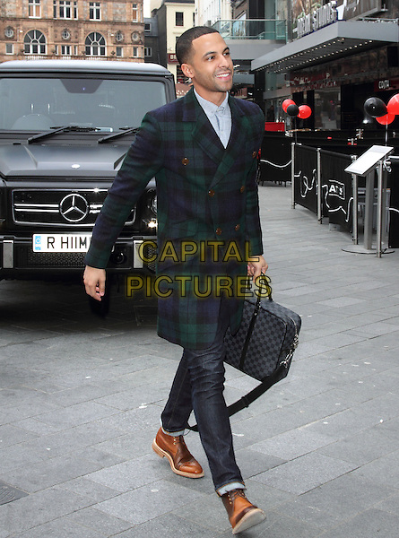 Marvin Humes arrives for his 1st Day at work at Capital FM, Leicester Square, London, England..28th March 2013.jls full length green blue check plaid tartan jacket coat jeans denim briefcase jeans denim brown shoes profile .CAP/ROS.©Steve Ross/Capital Pictures..