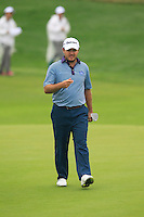 Richard Sterne (RSA) walks onto the 9th green during Thursday's Round 1 of the 2014 BMW Masters held at Lake Malaren, Shanghai, China 30th October 2014.<br /> Picture: Eoin Clarke www.golffile.ie