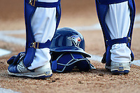 Dunedin Blue Jays catcher Mike Reeves helmet and mask on the ground during the national anthem before a game against the Brevard County Manatees on April 23, 2015 at Florida Auto Exchange Stadium in Dunedin, Florida.  Brevard County defeated Dunedin 10-6.  (Mike Janes/Four Seam Images)