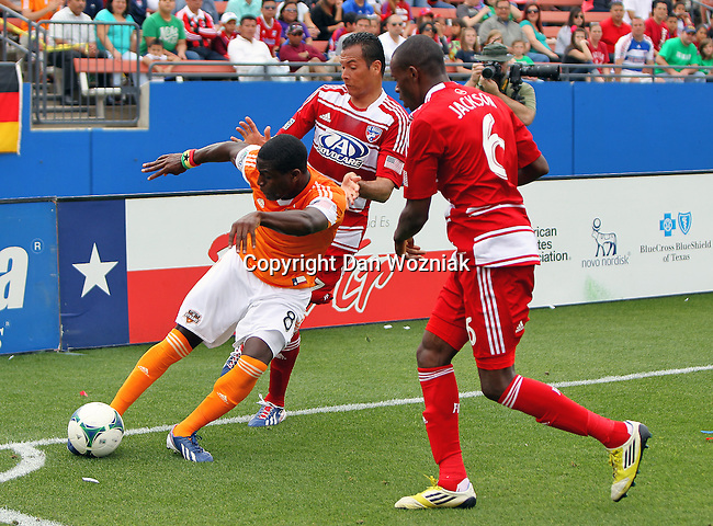 Houston Dynamo defender Kofi Sarkodie (8) in action during the game between the FC Dallas and the Houston Dynamo at the FC Dallas Stadium in Frisco,Texas.