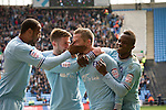 Coventry City 1 Birmingham City 1, 10/03/2012. Ricoh Arena, Championship. Gary McSheffrey (second right) is congratulated by teammates after opening the scoring at the Ricoh Arena, as Coventry City host Birmingham City in an Npower Championship fixture. The match ended in a one-all draw, watched by a crowd of 22,240. The Championship was the division below the top level of English football. Photo by Colin McPherson.