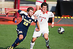 Wisconsin Badgers midfielder Kyle McCrudden (3) battles for the ball against Michigan Wolverines defenseman Matt Schmitt (22) during an NCAA soccer game at the McClimon Memorial Track/Soccer Complex in Madison, Wisconsin on October 10, 2010. Michigan beat Wisconsin 3-2. (Photo by David Stluka)