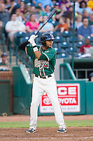 Rehiner Cordova (11) of the Greensboro Grasshoppers at bat against the Hagerstown Suns at NewBridge Bank Park on June 21, 2014 in Greensboro, North Carolina.  The Grasshoppers defeated the Suns 8-4. (Brian Westerholt/Four Seam Images)
