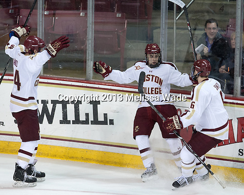 Bill Arnold (BC - 24), Johnny Gaudreau (BC - 13), Steven Santini (BC - 6) - The Boston College Eagles defeated the visiting Northeastern University Huskies 4-2 (EN) on Friday, November 1, 2013, at Kelley Rink in Conte Forum in Chestnut Hill, Massachusetts.