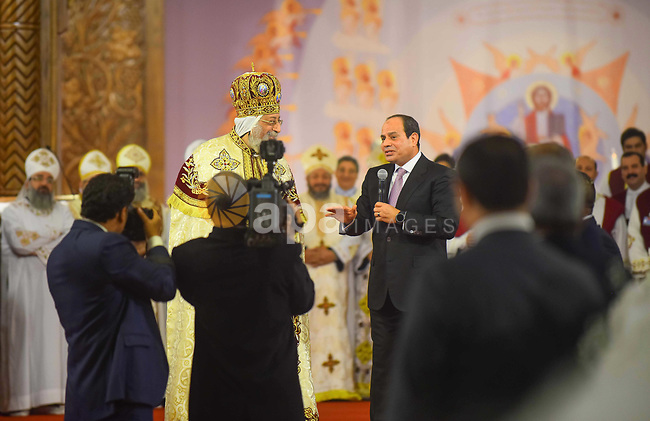 Egyptian President Abdel Fattah al-Sisi speaks during a Christmas Eve mass at the Nativity of Christ Cathedral in Cairo on January 6, 2018. Coptic Orthodox Christians packed the newly built Nativity of Christ Cathedral for a Christmas Eve mass after a bloody year for the minority singled out by jihadists for attacks. Photo by Amr Sayed
