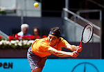 Taylor Fritz of USA in action against Novak Djokovic of Serbia during day five of the Mutua Madrid Open at La Caja Magica on May 07, 2019 in Madrid, Spain.