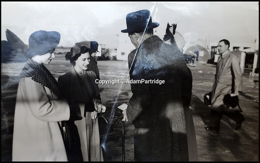 BNPS.co.uk (01202 558833)<br /> Pic: AdamPartridge/BNPS<br /> <br /> Alexander Usher pictured carrying bags in the background.<br /> <br /> A fascinating photo archive that documents the dedication of one of the Queen's bodyguards has come to light 70 years later.<br /> <br /> Police Inspector Alexander Usher was appointed 'No.1 Shadow' to Princess Elizabeth in 1944, when she was aged 18 and 'heir presumptive' to the throne behind her father King George VI.<br /> <br /> Mr Usher served alongside her until 1951, by which time she had married Prince Philip. He even went on their honeymoon.<br /> <br /> The album of photo which he features in is now being sold by Adam Partridge auctioneers.