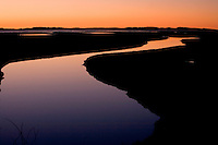 A colorful twilight in the back bay water channels at Morro Bay on the California central coast.